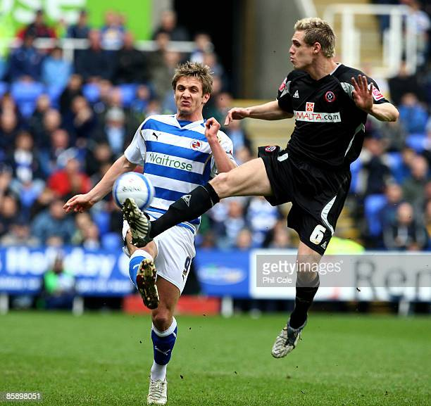 Kevin Doyle of Reading gets tackled by Matthew Kilgallon of Sheffield United during the Coca Cola Championship match between Reading and Sheffield...