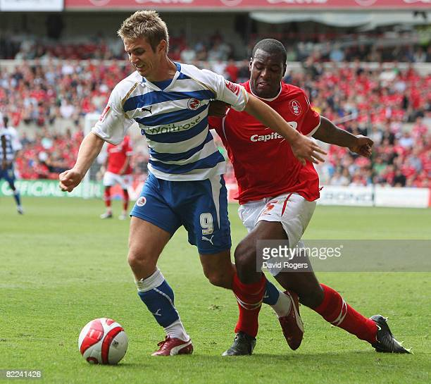 Kevin Doyle of Reading is tackled by Wes Morgan of Nottingham during the Coca Cola Championship match between Nottingham Forest and Reading at the...