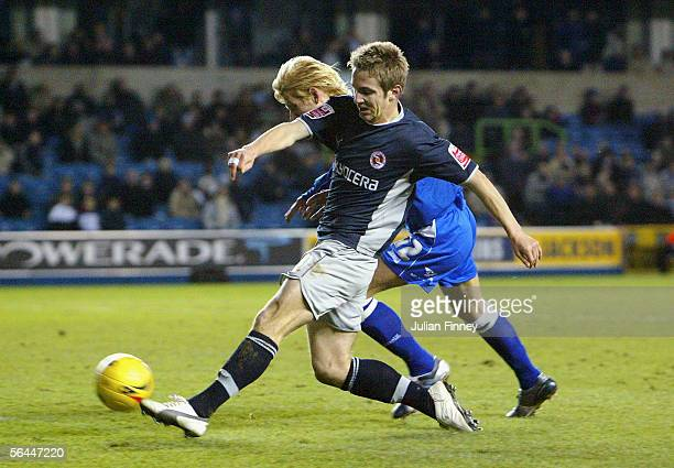 Kevin Doyle of Reading scores his teams second goal during the CocaCola Championship match between Millwall and Reading at The New Den on December 17...
