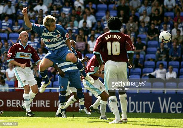 Kevin Doyle of Reading scores the second goal during the CocaCola Championship match between Reading FC and Burnley FC at the Madejski Stadium on...