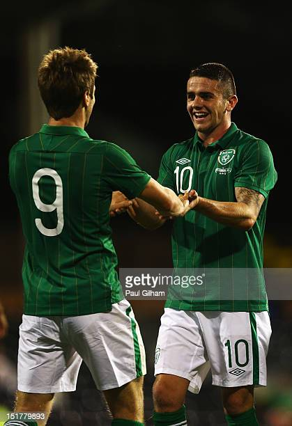 Kevin Doyle of Republic of Ireland celebrates with Robbie Brady after scoring the third goal for Ireland during the International Friendly match...