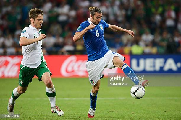 Kevin Doyle of Republic of Ireland closes down Federico Balzaretti of Italy during the UEFA EURO 2012 group C match between Italy and Ireland at The...
