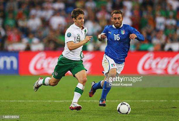 Kevin Doyle of Republic of Ireland is closed down by Daniele De Rossi of Italy during the UEFA EURO 2012 group C match between Italy and Ireland at...