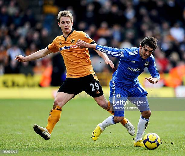 Kevin Doyle of Wolverhampton and Paulo Ferreira of Chelsea battle for the ball during the Barclays Premier League match between Wolverhampton...