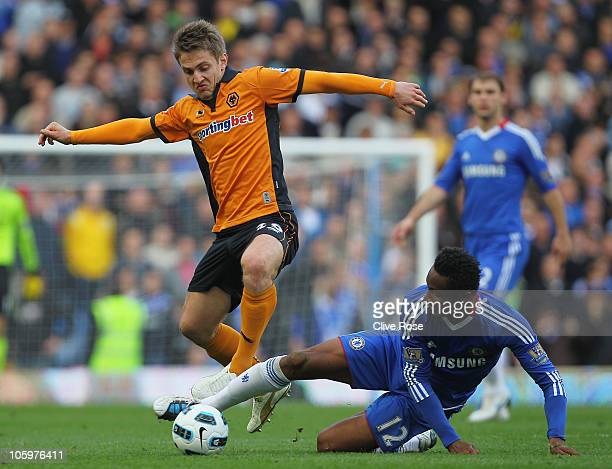 Kevin Doyle of Wolverhampton Wanderers is challenged by Mikel of Chelsea during the Barclays Premier League match between Chelsea and Wolverhampton...
