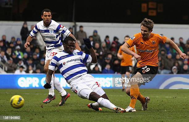 Kevin Doyle of Wolverhampton Wanderers scores his side's second goal as Taye Taiwo of Queens Park Rangers attempts to block the shot during the...