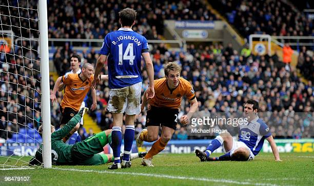 Kevin Doyle of Wolverhampton Wanderers wheels away to celebrate scoring the first goal during the Barclays Premier League match between Birmingham...
