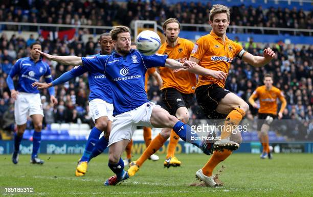 Kevin Doyle of Wolves and Wade Elliot of Birmingham battle for the ball during the npower Championship match between Birmingham City and...
