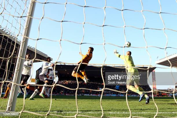 Kevin Doyle of Wolves heads to score the opening goal during the Barclays Premier League match between Wolverhampton Wanderers and Tottenham Hotspur...