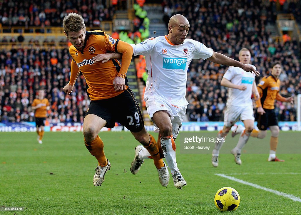Kevin Doyle of Wolves (L) in action with Alex Baptiste of Blackpool during the Barclays Premier League match between Wolverhampton Wanderers and Blackpool at Molineux on February 26, 2011 in Wolverhampton, England.