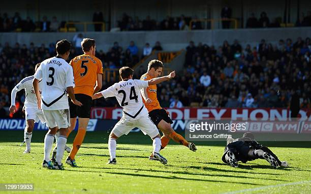 Kevin Doyle of Wolves scores his teams first goal during the Barclays Premier League match between Wolverhampton Wanderers and Swansea City at...