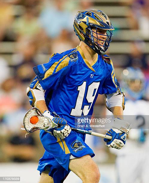 Kevin Drew of the Charlotte Hounds carries the ball up the field against the Ohio Machine at American Legion Memorial Stadium on June 8 2013 in...