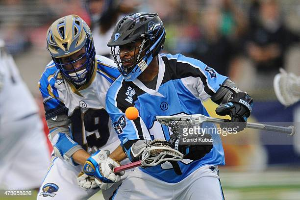 Kevin Drew of the Charlotte Hounds knocks the ball free from Kyle Harrison of the Ohio Machine at Selby Stadium on May 16 2015 in Delaware Ohio