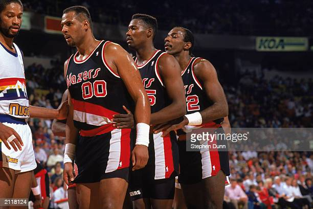 Kevin Duckworth Jerome Kersey and Clyde Drexler of the Portland Trail Blazers wait for the inbounds pass against the Denver Nuggets during the...