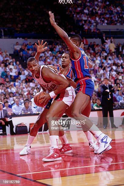 Kevin Duckworth of the Portland Trailblazers drives against Dennis Rodman of the Detroit Pistons at the Veterans Memorial Coliseum in Portland Oregon...
