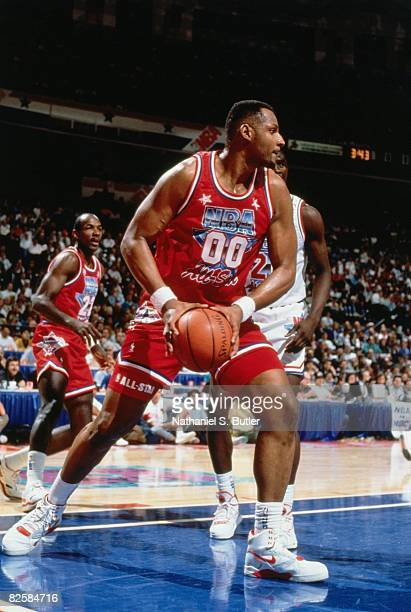 Kevin Duckworth of the Western Conference AllStars rebounds during the 1991 NBA AllStar Game at the Charlotte Coliseum in Charlotte North Carolina...