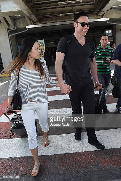 Kevin Durand and Sandra Cho are seen arriving in Nice for the 67th Annual Cannes Film Festival on May 15 2014 in Nice France
