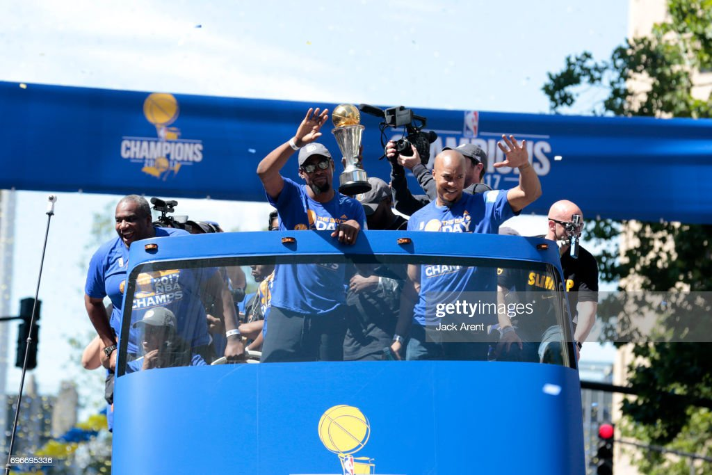 Kevin Durant #35 and David West #3 of the Golden State Warriors celebrates winning the 2017 NBA Championship during a parade on June 15, 2017 in Oakland, CA.