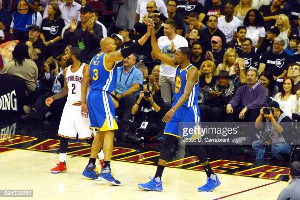 Kevin Durant and David West of the Golden State Warriors high five each other during the game against the Cleveland Cavaliersin Game Four of the 2017...