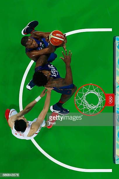 Kevin Durant and DeAndre Jordan of United States go for the rebound against Qi Zhou of China in the Men's Preliminary Round Group A match on Day 1 of...
