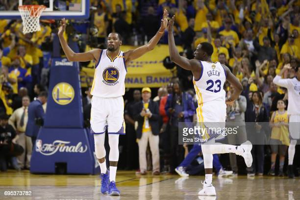 Kevin Durant and Draymond Green of the Golden State Warriors celebrate after a play in Game 5 of the 2017 NBA Finals against the Cleveland Cavaliers...