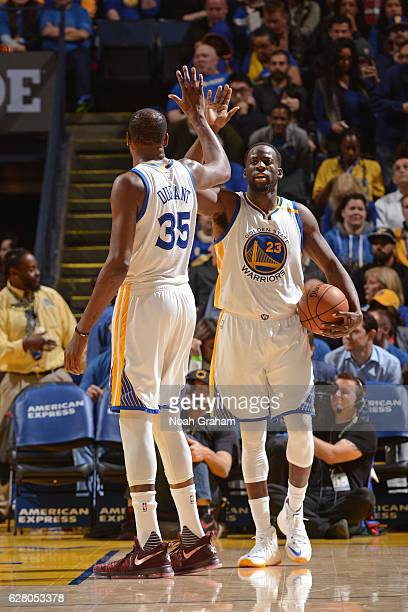 Kevin Durant and Draymond Green of the Golden State Warriors high five during the game against the Indiana Pacers on December 5 2016 at ORACLE Arena...
