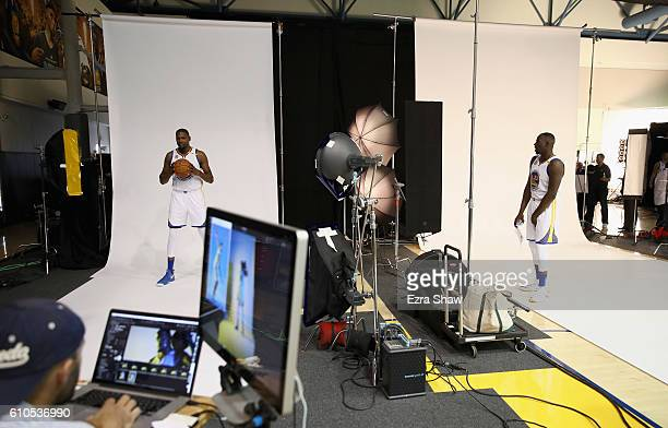 Kevin Durant and Draymond Green of the Golden State Warriors pose for photographers during the Golden State Warriors Media Day at the Warriors...