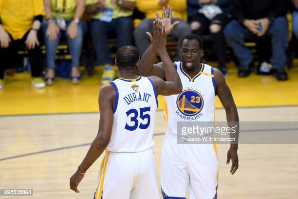 Kevin Durant and Draymond Green of the Golden State Warriors react to a play in Game 5 of the 2017 NBA Finals against the Cleveland Cavaliers at...