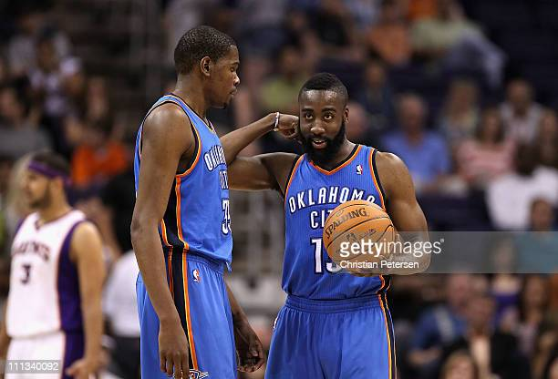Kevin Durant and James Harden of the Oklahoma City Thunder talk during the NBA game against the Phoenix Suns at US Airways Center on March 30 2011 in...