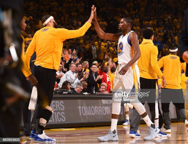 Kevin Durant and JaVale McGee of the Golden State Warriors high five each other during the game against the San Antonio Spurs during Game Two of the...