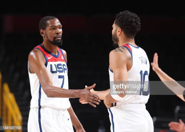Kevin Durant and Jayson Tatum of Team United States celebrates against Islamic Republic of Iran during the first half of a Men's Preliminary Round...