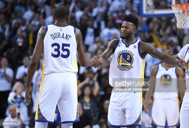 Kevin Durant and Jordan Bell of the Golden State Warriors slap hands after Durant blocked the shot of LeBron James of the Cleveland Cavaliers late in...