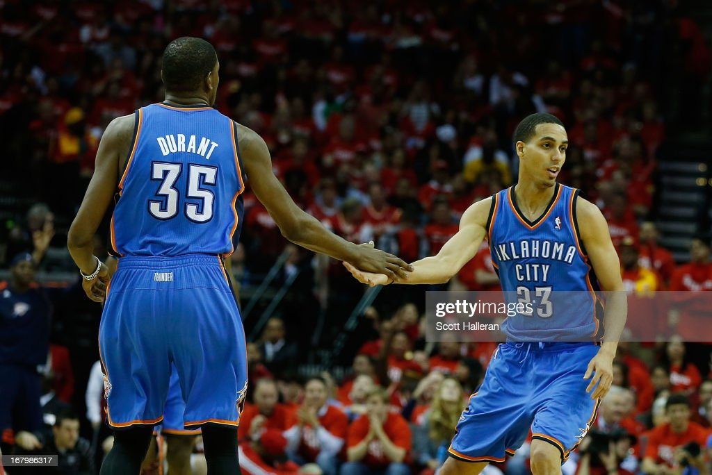 Kevin Durant #35 and Kevin Martin #23 of the Oklahoma City Thunder celebrate a play during the game against the Houston Rockets in Game Six of the Western Conference Quarterfinals of the 2013 NBA Playoffs at the Toyota Center on May 3, 2013 in Houston, Texas.