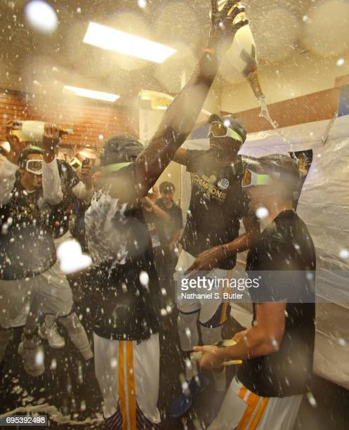 Kevin Durant and Klay Thompson of the Golden State Warriors celebrates in the locker room after winning the NBA Championsip in Game Five of the 2017...