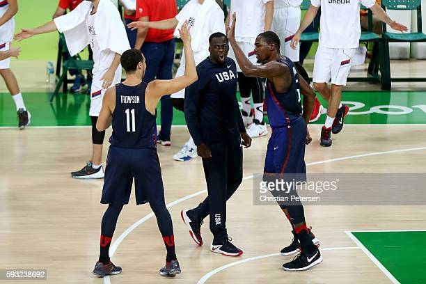 Kevin Durant and Klay Thompson of United States react after a play against Serbia during the Men's Gold medal game on Day 16 of the Rio 2016 Olympic...
