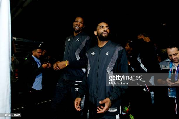 Kevin Durant and Kyrie Irving of Team LeBron are seen during the 2019 NBA AllStar Game on February 17 2019 at the Spectrum Center in Charlotte North...