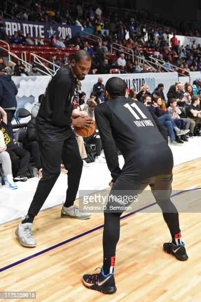 Kevin Durant and Kyrie Irving of Team LeBron guard each other during the 2019 NBA AllStar Practice and Media Availability on February 16 2019 at...