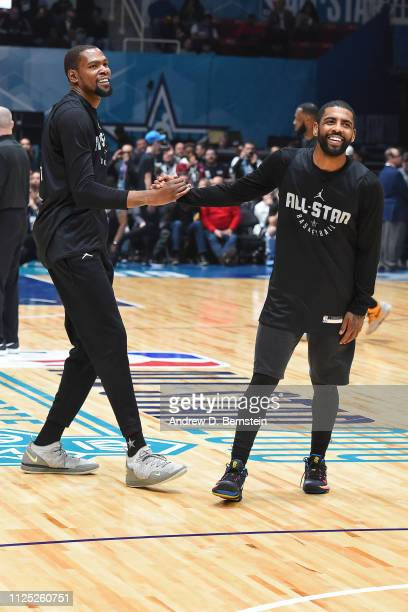Kevin Durant and Kyrie Irving of Team LeBron shake hands during the 2019 NBA AllStar Practice and Media Availability on February 16 2019 at Bojangles...