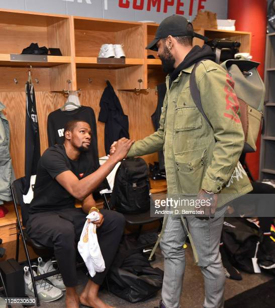 Kevin Durant and Kyrie Irving of Team LeBron shake hands in the locker room before the 2019 NBA AllStar Practice and Media Availability on February...