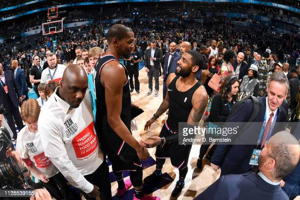 Kevin Durant and Kyrie Irving of Team LeBron talk after the 2019 NBA AllStar Game on February 17 2019 at the Spectrum Center in Charlotte North...