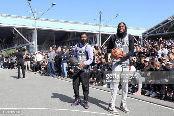 Kevin Durant and Kyrie Irving of the Brooklyn Nets handles the ball during Practice in the Park on October 5 2019 at Brooklyn Bridge park Pier 2...