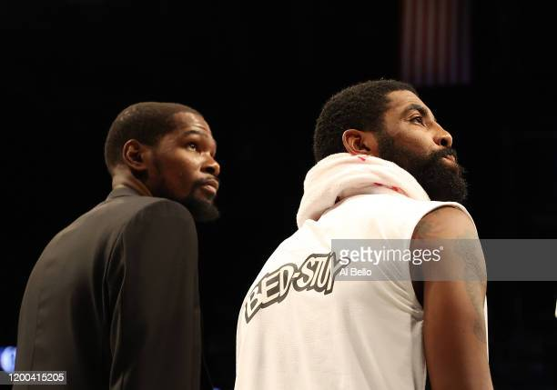 Kevin Durant and Kyrie Irving of the Brooklyn Nets look on during their game against the Milwaukee Bucks at Barclays Center on January 18 2020 in New...
