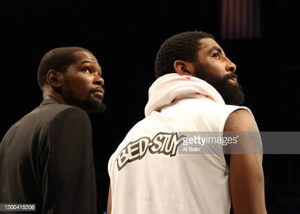 Kevin Durant and Kyrie Irving of the Brooklyn Nets look on during their game against the Milwaukee Bucks at Barclays Center on January 18, 2020 in...