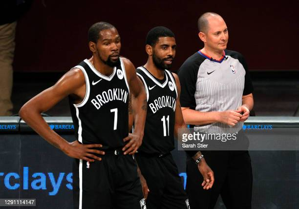 Kevin Durant and Kyrie Irving of the Brooklyn Nets look on with the referee during the first half against the Washington Wizards at Barclays Center...