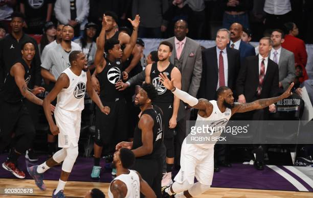 Kevin Durant and LeBron James celebrate as Stephen Curry looks on after Team LeBron defeated Team Stephen 148145 at the 2018 NBA AllStar Game...
