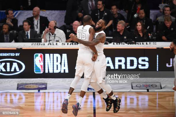 TOPSHOT Kevin Durant and LeBron James celebrate as Team LeBron defeated Team Stephen 148145 at the 2018 NBA AllStar Game February 18 2018 at Staples...