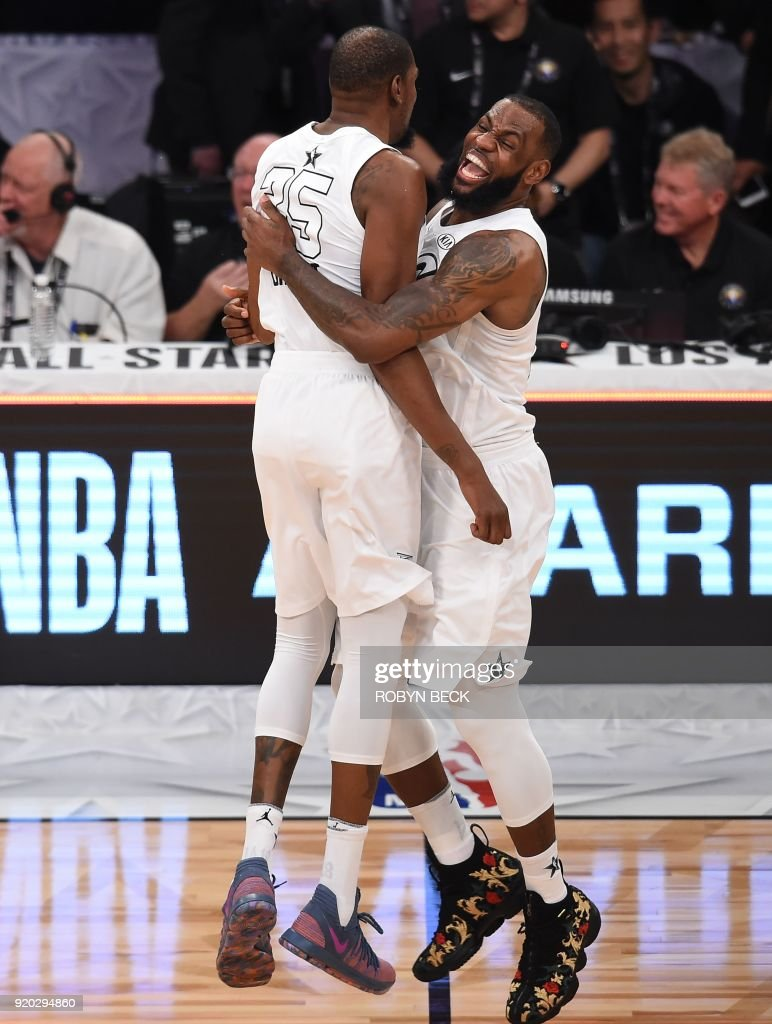Kevin Durant (L) and LeBron James celebrate as Team LeBron defeated Team Stephen 148-145 at the 2018 NBA All-Star Game, February 18, 2018 at Staples Center in Los Angeles, California. / AFP PHOTO / Robyn Beck