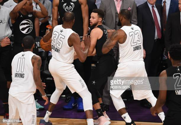 Kevin Durant and LeBron James double team Stephen Curry in the final minute of the 2018 NBA AllStar Game February 18 2018 at Staples Center in Los...