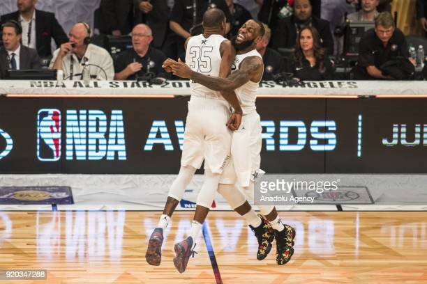 Kevin Durant and LeBron James of Team Lebron celebrate on the court after Team Lebron defeats Team Stephen during the 2018 NBA AllStar Game at the...