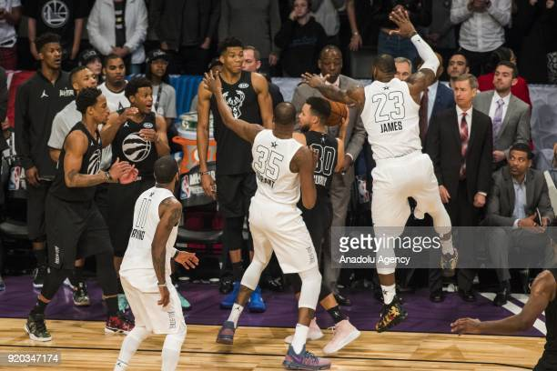 Kevin Durant and LeBron James of Team Lebron crowd Stephen Curry during the final seconds of the fourth quarter preventing him from making a shot to...